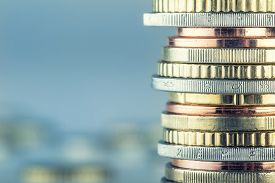 stock photo of money  - Euro coins. Euro money. Euro currency.Coins stacked on each other in different positions. Money concept - JPG