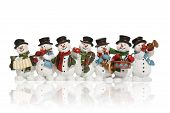 foto of christmas song  - snowmen playing music instruments isolated over white - JPG