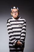 pic of prison uniform  - Funny prisoner isolated on gray - JPG