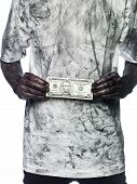 stock photo of doughy  - Very dirty person holding a five dollar bank note - JPG
