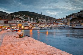 stock photo of hydra  - Yachts mooring at a quay at the busiest part of the port in Hydra - JPG