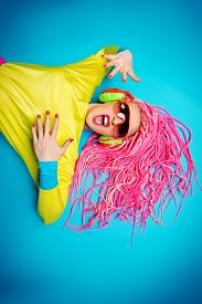 stock photo of dreadlock  - Crazy expressive trendy DJ girl in bright clothes - JPG