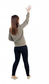 picture of waving hands  - Back view of beautiful woman welcomes - JPG