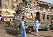 Pakistan, Karachi- NOVEMBER 14: Traditional pakistani buses, Drivers ask passengers, November 14, 2006
