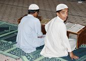 KARACHI, PAKISTAN - NOV 14: Unidentified boys study Koran in the Tooba Mosque on November 14, 2006 in Karachi, Pakistan. Tooba Mosque  the largest single dome mosque in the world