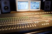 picture of recording studio  - Studio console with computer screens and audio monitors - JPG