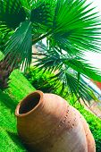 picture of loamy  - Large clay pitcher lying on grass - JPG