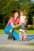 stock photo of roller-skating  - Mom and daughter in roller skates - JPG