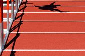Shadow of a Hurdler jumping, during a race
