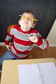 pic of fidget  - Bored student balancing a pencil on his nose - JPG