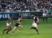 MELBOURNE - AUGUST 15: Collingwood's Alan Didak heads for goal  - Collingwood vs Richmond, August 15