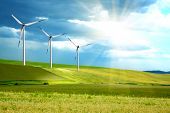 stock photo of wind energy  - Wind turbines farm on green island - JPG