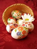 easter eggs and basket on red background