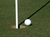 Golf Ball Next To A Flag