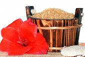 washtub with bath salt and red flower