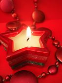 Red star candle on celebration background
