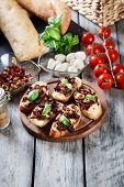 Постер, плакат: Appetizer Bruschetta With Sun dried Tomatoes Olives And Mozarel