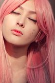 Japan Anime Cosplay. Close-up Portrait Of Young Attractive Asian Woman With Creative Make-up And Wea poster