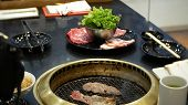 Food In Bulgogi , Korean Barbecue, In The Restaurant. Cooking In The Chinese Restaurant On The Table poster