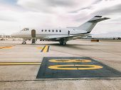 Private Luxury Jet At The Airport Terminal poster