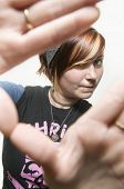 Red hair teen girl framing scene with hands