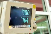 Vital Sign And Heart Rate Monitor In Hospital With Numbers Of Heart Rate And Pulse On Screen. poster