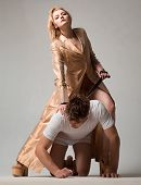 Dominant Womans. Dominantning In The Foreplay Sexual Game. Shop With Bondage And Bdsm. Woman And Man poster