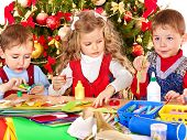 pic of card-making  - Children boy and girl making decoration for Christmas - JPG