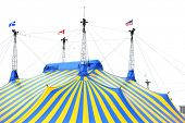 A yellow and blue circus tent in the city