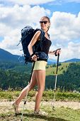 Pretty Happy Woman Backpacker Hiking Mountain Trail, Walking On Grassy Hill, Wearing Backpack And Su poster