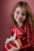 litle girl with red gift box