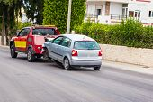Crashed Car Being Towed Away By Tow Truck After Accident poster