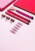 Pink Paper Clips, Pink Notebook And Pink Pencil Case On A Pink Background. poster
