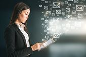 Side View Of Young European Businesswoman Using Tablet With Abstract Emails. E-mail Marketing Concep poster
