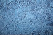 stock photo of linoleum  - The sample of natural linoleum of dark blue color - JPG