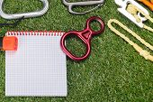 Paper And Expedition Items On Green Grass poster
