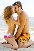 Beautiful couple kissing on the sea shore