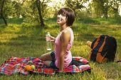 Lovely girl having a rest on picnic in the park