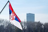 Photo Of The Official Flag Of The Republic Of Serbia, In Front Of A Business Building In Belgrade, S poster