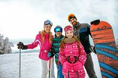 family enjoying winter vacations in mountains. Ski, Sun, Snow and fun poster
