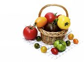 Wicker Basket Full Of Fresh Ripe Red, Yellow, Green And Black Tomatoes In Wicker Basket On Checkered poster