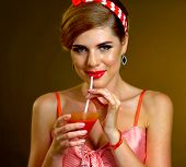 Pin up girl drink bloody Mary cocktail. Pin-up retro female style. Smiling happy girl wearing red dr poster