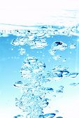 Water bubbles and action over white background