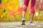 Leg muscle cramp calf sport injury outdoors exercise. poster