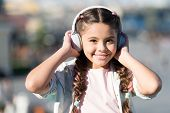 Enjoy Life Being Happy. Music Makes Me Happy. Happy Little Child. Little Child Listen To Music Outdo poster