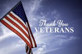 American Flags With A Veterans Day Greeting With Blue Sky Baacakground poster
