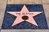 LOS ANGELES - OCTOBER 16: The Beatles star in Hollywood Walk of Fame on October 16, 2011 in Los Angeles, CA. There are more than 2,400 five-pointed stars attracts about 10 million visitors annually