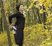 Stretching Before Jogging. Running. Morning Jogging Girl Practicing Sport. Sport With Forest poster