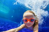 Happy Family In Swimming Pool. Smiling Child In Goggles Swim, Dive In Pool With Fun - Jump Deep Down poster