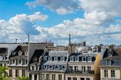 Cityscape Of Paris With Parisian Roofs And Eiffel Tower In Background, Paris France poster